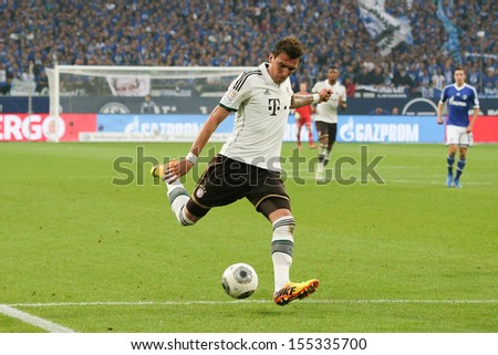 SCHALKE, GERMANY - SEP 21: Mario Mandzukic (FC Bayern) during a Bundesliga match between FC Schalke 04 & FC Bayern Munich, final score 0-4, on September 21, 2013, in Schalke, Germany. - stock photo
