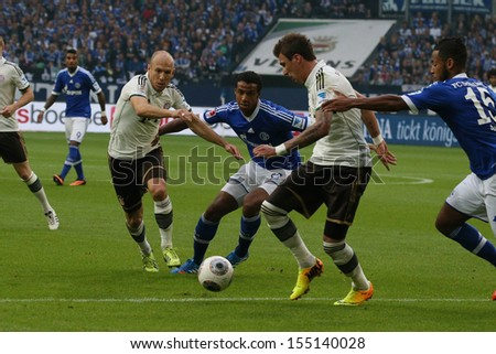 SCHALKE, GERMANY - SEP 21: Robben & Mandzukic (Bayern) vs. Matip (Schalke) during a Bundesliga match between FC Schalke 04 & FC Bayern Munich on September 21, 2013, in Schalke, Germany. - stock photo