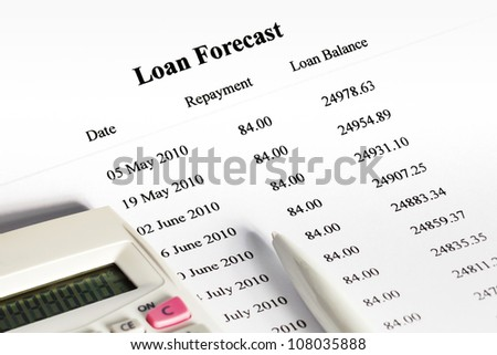 Schedule of payments for loan with calculator and pen. - stock photo