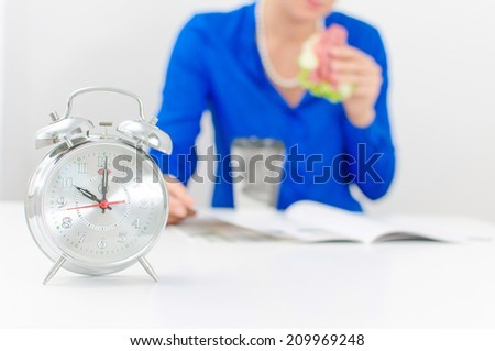 Schedule of the day. Morning. Woman having breakfast. - stock photo
