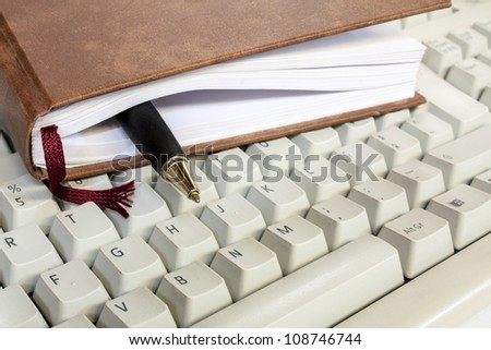 schedule with pen and keyboard clouse up - stock photo