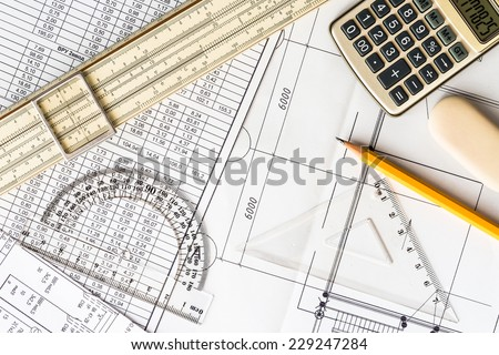 Schemes on the table, draw a pencil, draw a ruler and calculator - stock photo