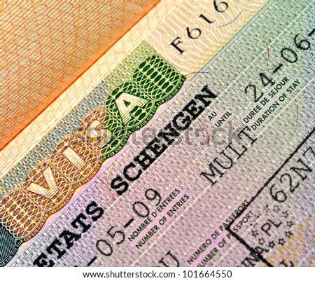 Schengen Visa on passport page - stock photo