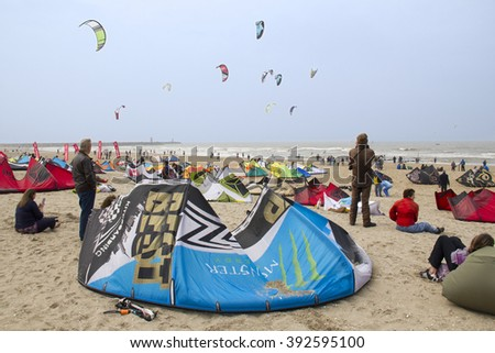 SCHEVENINGEN, HOLLAND - MAY 20: Kite surfers wait for good wind at the World Cup Kite Surfing in Scheveningen, Holland on May 20, 2012. - stock photo