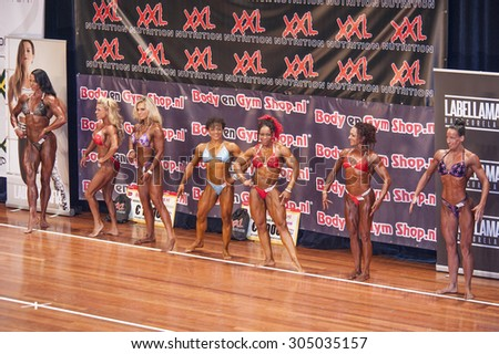 SCHIEDAM, THE NETHERLANDS - APRIL 26, 2015: Female bikini models Naima Benamari, Mariska Meuissen show their best at the 38th Dutch National Championship Bodybuilding and Fitness.