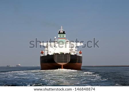 schip leaving Port of Rotterdam - stock photo