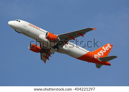 SCHIPHOL, AMSTERDAM, NETHERLANDS - APRIL 1, 2016: Airbus A320-214 G-EZUA of EasyJet low cost airlines taking off at Schiphol international airport.
