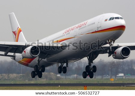SCHIPHOL, AMSTERDAM, NETHERLANDS - APRIL 2, 2016: Airbus A340-313 PZ-TCR of Surinam Airways landing at Schiphol international airport.