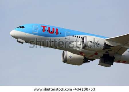 SCHIPHOL, AMSTERDAM, NETHERLANDS - APRIL 1, 2016: Boeing 787-8 Dreamliner PH-TFK of TUI Airlines Nederland Arkefly taking off at Schiphol international airport.