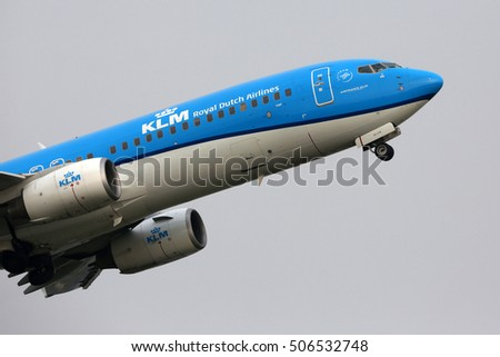 SCHIPHOL, AMSTERDAM, NETHERLANDS - APRIL 2, 2016: Boeing 737-8K2(WL) PH-BHZ in new colors of KLM Royal Dutch Airlines taking off at Schiphol international airport.