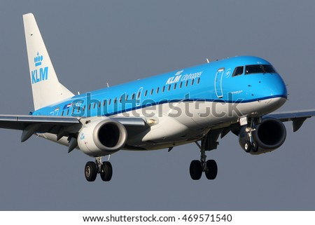SCHIPHOL, AMSTERDAM, NETHERLANDS - APRIL 3, 2016: Embraer ERJ-190STD PH-EZL KLM Cityhopper Royal Dutch Airlines landing at Schiphol international airport.