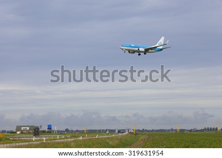 Schiphol, Netherlands - AUGUST 29, 2015: Air plane landing at Amsterdam International Airport in The Netherlands.