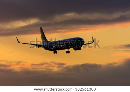 Schiphol, Noord-Holland/Netherlands - February 22-02-2016 - Plane from KLM is landing at Schiphol airport. Photo taken during a sunrise at Schiphol airport.