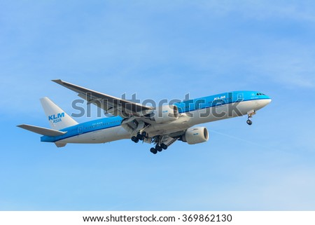 Schiphol, Noord-Holland/Netherlands - January 18-01-2016 -Flying Airplane KLM Royal Dutch Airlines PH-BQM Asia Boeing 777-200 is landing at Schiphol airport. The plane is flying to the runway.