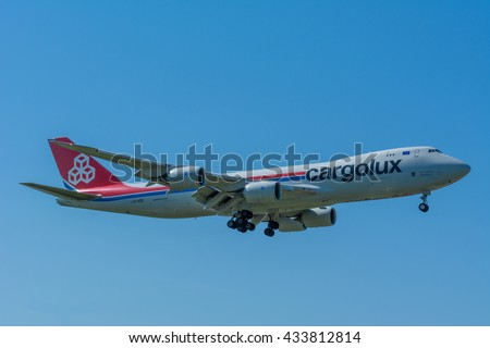 Schiphol, Noord-Holland/Netherlands - June 6-6-2016 - Airplane Cargolux Airlines International LX-VCE Boeing 747-8F is landing at Schiphol airport. The plane is flying to the runway. - stock photo