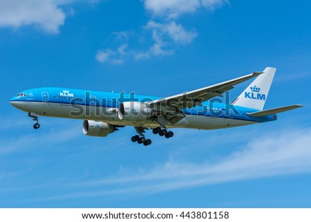 Schiphol, Noord-Holland/Netherlands - June 16-06-2016 - Airplane KLM Royal Dutch Airlines PH-BQB Boeing 777-200 is flying to the runway. The Commercial jet started the landing gear system for landing.