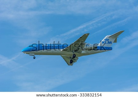 Schiphol, Noord-Holland/Netherlands- October 31-10-2015 -Plane from KLM Cityhopper PH-KZP Fokker F70 is started landing at Schiphol Airport. Nice blue sky at the background of the Airplane.