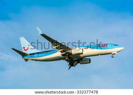 Schiphol, Noord-Holland/Netherlands- October 26-10-2015 -Plane from TUI (Arkefly) Boeing 737-800 PH-TFF is preparing for landing at Schiphol airport. Blue cloudy sky at the background of the airplane.