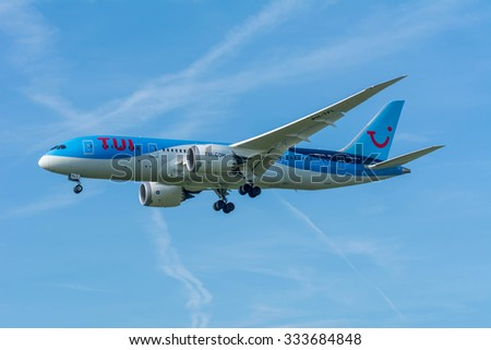 Schiphol, Noord-Holland/Netherlands- October 31-10-2015 -Plane from TUI PH-TFL Boeing 787-8 Dreamliner is started landing at Schiphol Airport. Nice blue sky at the background of the Airplane.