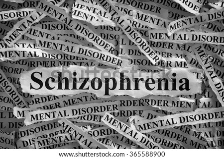 Schizophrenia. Torn pieces of paper with the word Schizophrenia and mental disorder. Concept Image. Black and White. Closeup.