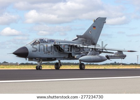SCHLESWIG, GERMANY - JUN 23, 2014: German Air Force Tornado from AG-51 taxiing at the NATO Tiger Meet at Schleswig-Jagel airbase. The Meeting Meet is to promote solidarity between NATO air forces - stock photo
