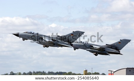 SCHLESWIG, GERMANY - JUN 23, 2014: German Air Force Tornado's from AG-51 taking off at the NATO Tiger Meet at Schleswig-Jagel airbase. The Meeting Meet is to promote solidarity between NATO air forces - stock photo