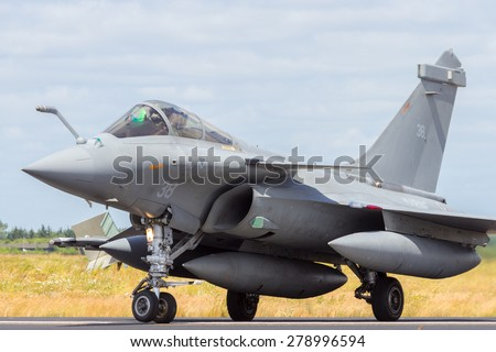SCHLESWIG-JAGEL, GERMANY - JUN 23, 2014: French Navy Dassault Rafale during the NATO Tiger Meet at Schleswig-Jagel airbase. The Tiger Meet is to promote solidarity between NATO air forces - stock photo