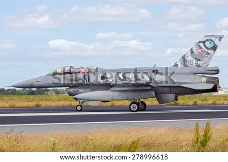 SCHLESWIG-JAGEL, GERMANY - JUN 23, 2014: Polish Air Force F-16 fighter jet during the NATO Tiger Meet at Schleswig-Jagel airbase. The Tiger Meet is to promote solidarity between NATO air forces - stock photo