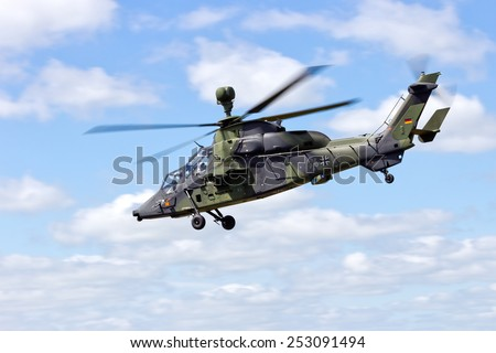 SCHLESWIG-JAGEL,  GERMANY - MAY 22: EC665 Tiger attack helicopter flying during the NATO Tiger Meet at Schleswig-Jagel airbase. The Tiger Meet is to promote solidarity between NATO air forces - stock photo