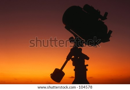 Schmidt-Cassegrain telescope silhouette at sunrise