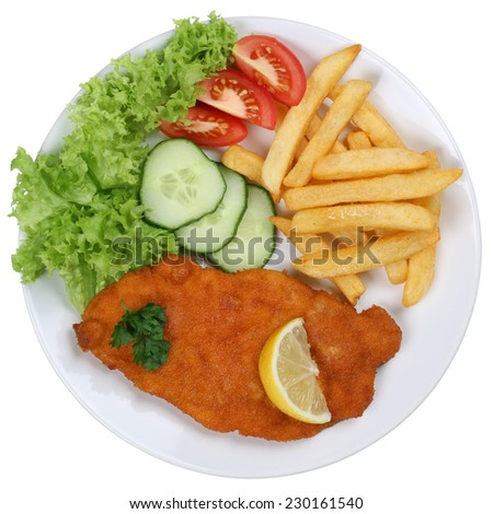 Schnitzel chop cutlet meal with french fries, vegetables and lettuce on plate isolated on a white background - stock photo