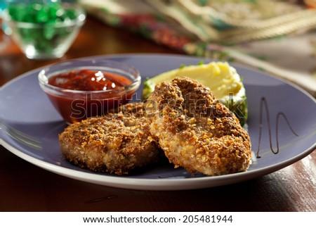 Schnitzel Served with Mashed Potato - stock photo