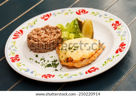 schnitzel with buckwheat - stock photo