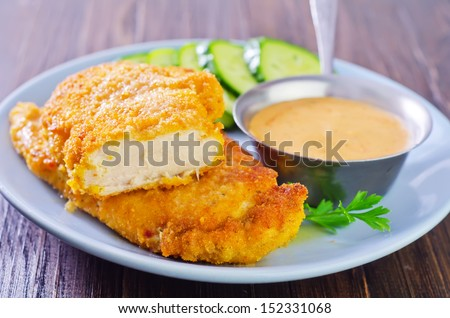 schnitzel  with sauce - stock photo