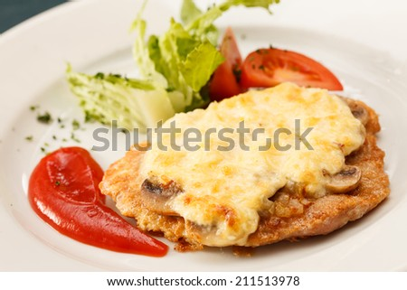 Schnitzel with vegetables - stock photo
