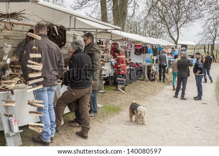 SCHOKLAND, NETHERLANDS - APRIL 21: People on Scandinavian day street party on april 21, 2013 in Schokland. Schokland is beauty old UNESCO village.