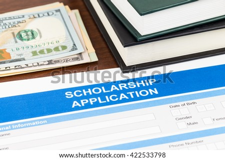 Scholarship application form with dollar banknote and text book - stock photo