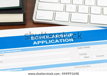 Scholarship application form with  keyboard, and text book