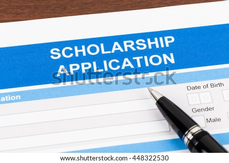 Scholarship application form with pen