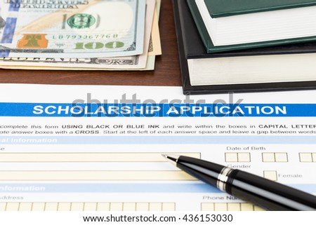 Scholarship application form with pen, dollar banknote and text book - stock photo