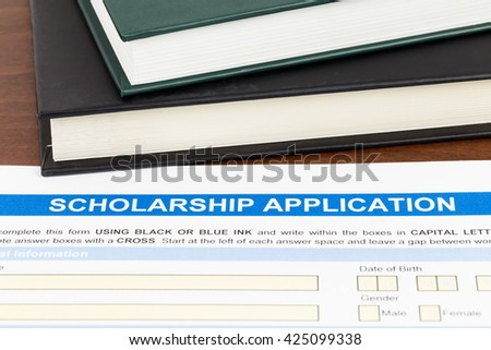 Scholarship application form with  text book - stock photo