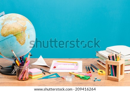 School accessories on desktop with plain background - stock photo