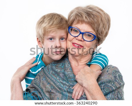 School-age grandson and an elder grandmother, portrait on a white background - stock photo