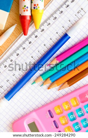 School and art supplies on a wood background - stock photo