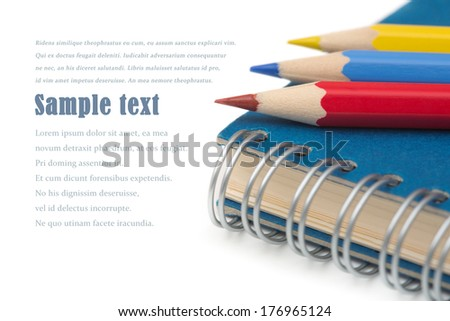 School and office stationery. Colorful pencils and notebook isolated over white with copyspace.  - stock photo