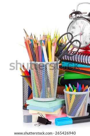 School and office supplies and alarm clock. Isolated on white background - stock photo