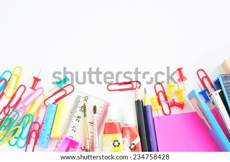 School and office supplies frame, on white background.