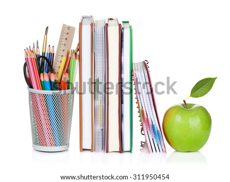 School and office supplies. Notepads, colorful pencils and apple. Isolated on white background - stock photo