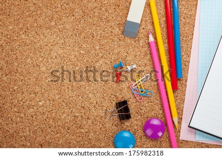 School and office supplies on cork wooden background with copy space - stock photo