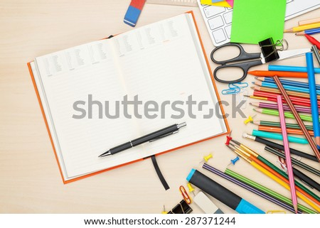 School and office supplies over office table. Top view with notepad for copy space - stock photo